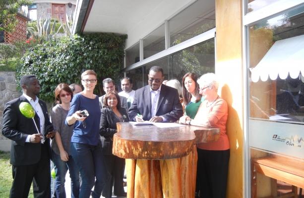 AGF's co-representative Adamou Garba signs